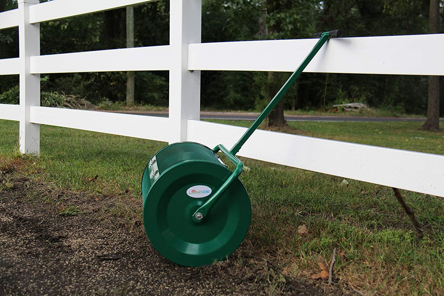 Landzie Peat Moss Spreader leaning on a fence
